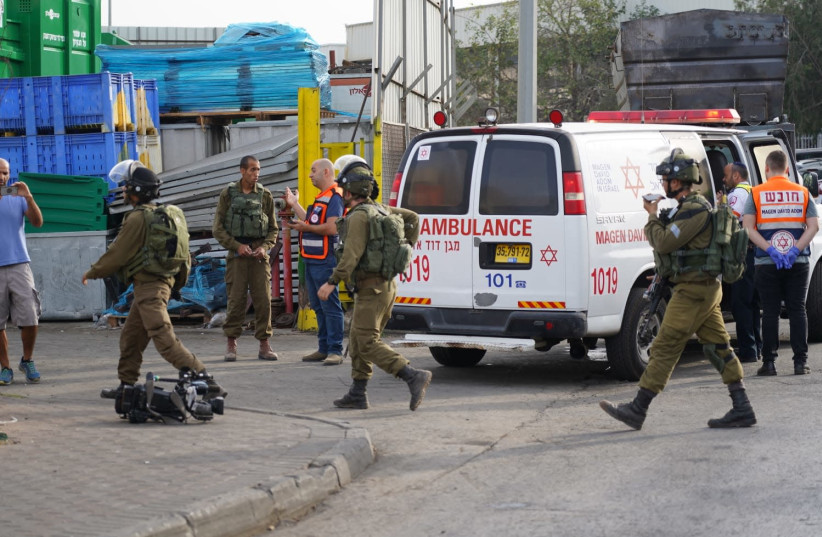 IDF and Magen David Adom at the sceneof the terror shooting in the Barkan industrial Zone (photo credit: HALLEL MEIR/TPS)