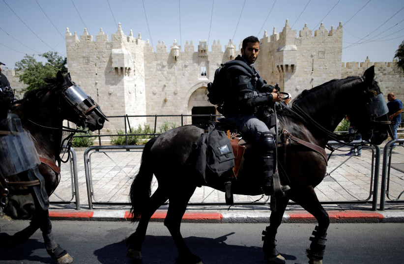 Israeli police ride their horses outside Damascus Gate at Jerusalem's Old city July 28, 2017.  (photo credit: AMIR COHEN/REUTERS)