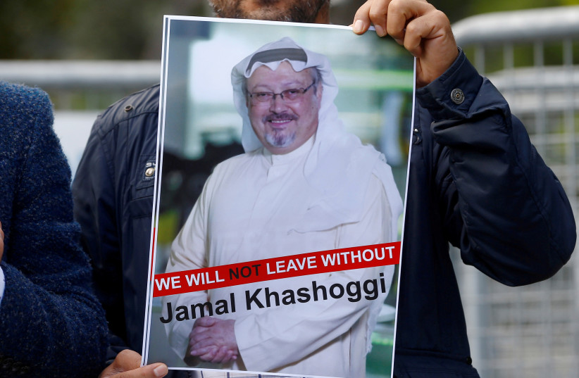 A demonstrator holds picture of Saudi journalist Jamal Khashoggi during a protest in front of Saudi Arabia's consulate in Istanbul, Turkey, October 5, 2018 (photo credit: OSMAN ORSAL/REUTERS)