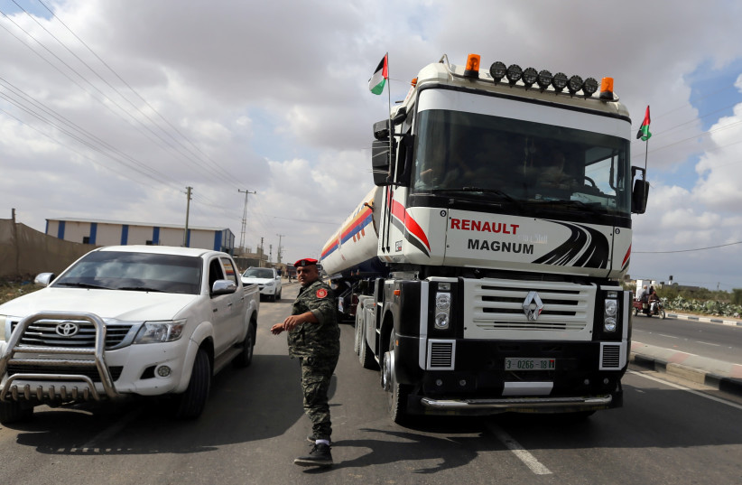 A fuel tanker bound for the Gaza power plant is seen in the central Gaza Strip October 9, 2018 (photo credit: IBRAHEEM ABU MUSTAFA / REUTERS)