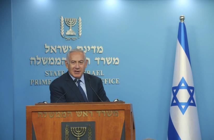 Prime Minister Benjamin Netanyahu speaking to reporters, October 9, 2018 (photo credit: MARC ISRAEL SELLEM/THE JERUSALEM POST)