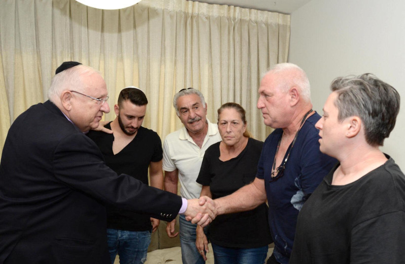 Israeli President Reuven Rivlin visited the families of the victims of the terror attack at Barkan Industrial Facility (photo credit: MARK NEYMAN/GPO)
