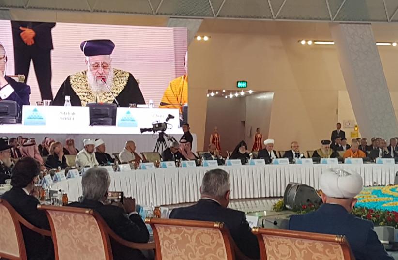 Rabbi Yosef Yitzhak addresses a panel of world religious leaders in Astana, Kazakhstan. (photo credit: CHIEF RABBINATE)