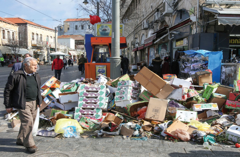 Trash piles up near the shuk during last winter's sanitation strike. (photo credit: MARC ISRAEL SELLEM)
