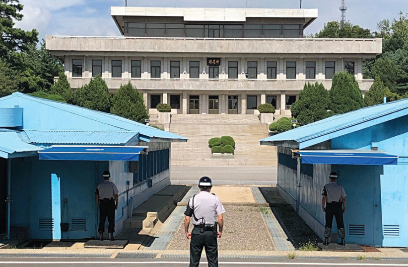 VIGILANT SOUTH Korean soldiers stand guard at the boundary with North Korea. (photo credit: MICHAEL FREUND)