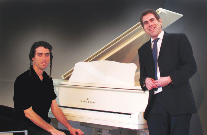 TUKACHINSKY AT the keyboard in a publicity photo with Yisrael Lutnick, with whom he performed for the 'Sinatra' concert and other shows. (photo credit: AMY LUTNICK)