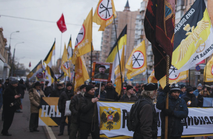 MEMBERS OF a Russian nationalist group attend a march of the Unity of Nation in Moscow last year. (photo credit: EKATERINA ANCHEVSKAYA/REUTERS)
