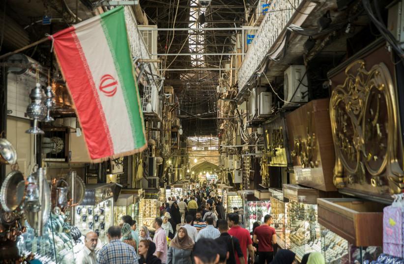 People shop at the Grand Bazaar in the center of Tehran, Iran, August 2, 2017 (photo credit: NAZANIN TABATABAEE YAZDI/ TIMA VIA REUTERS)
