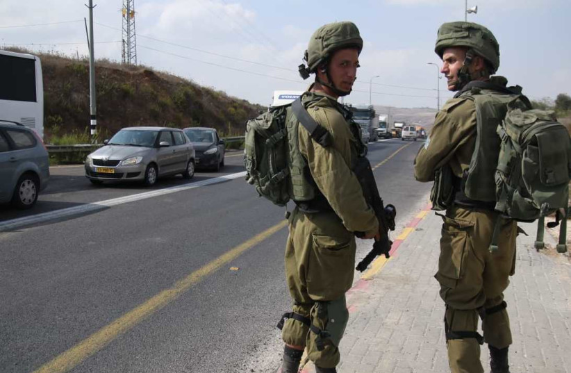 Soldiers at the scene of a stabbing attack in the West Bank on October 11, 2018. (photo credit: TAZPIT)