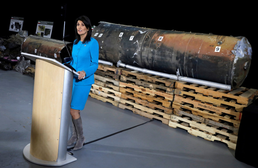 US Ambassador to the UN Nikki Haley briefs the media in front of remains of an Iranian 'Qiam' ballistic missile at Joint Base Anacostia-Bolling in Washington in December 2017. (photo credit: REUTERS/YURI GRIPAS)