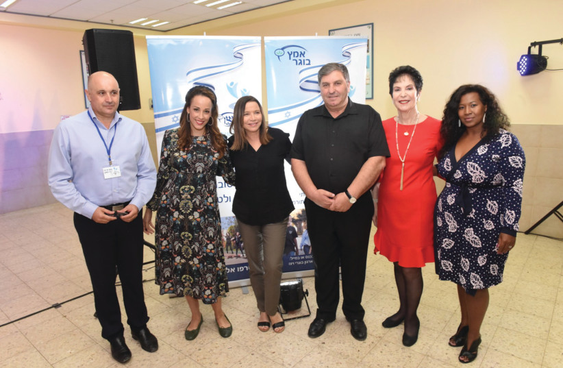 LEFT TO RIGHT: Brig.-Gen. (res.) David Suissa, former chief artillery officer and chairman of the WIZO Graduate Association; Eden Harel, MC; MK Shelly Yacimovich; Danny Atar, KKL-JNF chairman; Prof. Rivka Lazovsky, World WIZO chairperson; Oshra Yosef Friedman, chairwoman of the Authority for the Adv (photo credit: KFIR SIVAN)