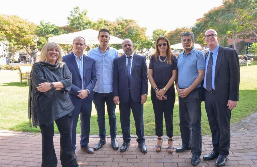 From right to left: Balashnikov, MK Yossi Yonah, MK Merav Ben-Ari, Margi, college CEO Ravi Gamish, MK Oded Ferer and Prof. Or a Ben Naftali, the college's rector. (photo credit: IDAN GROSS)