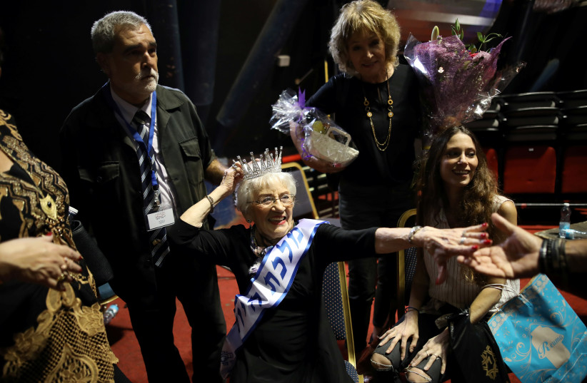 Holocaust survivor Tova Ringer, 93 year old, reacts after winning the annual Holocaust survivors' beauty pageant  (photo credit: REUTERS/CORINNA KERN)