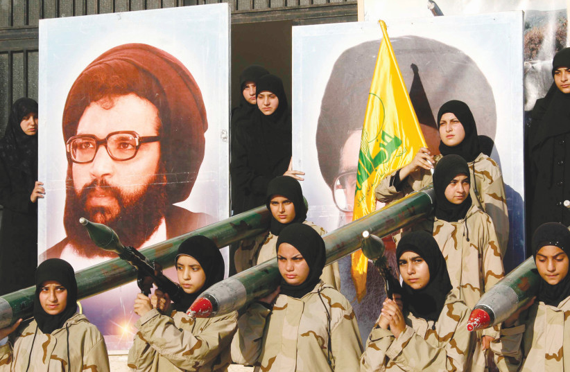 Iran's sponsorship of Hezbollah includes $800 million in annual financial support, the supply of 130,000 rockets and missiles (photo credit: REUTERS)