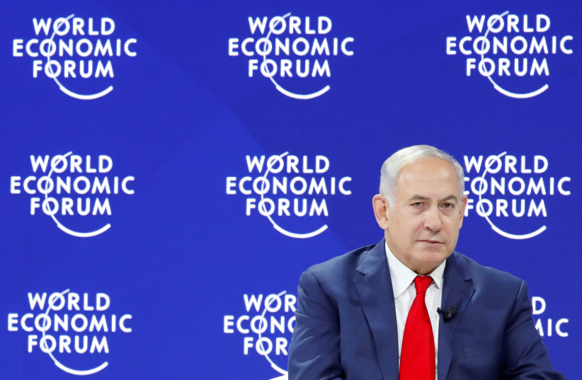 Israel's Prime Minister Benjamin Netanyahu attends the World Economic Forum (WEF) annual meeting in Davos, Switzerland January 25, 2018.  (photo credit: REUTERS/DENIS BALIBOUSE)