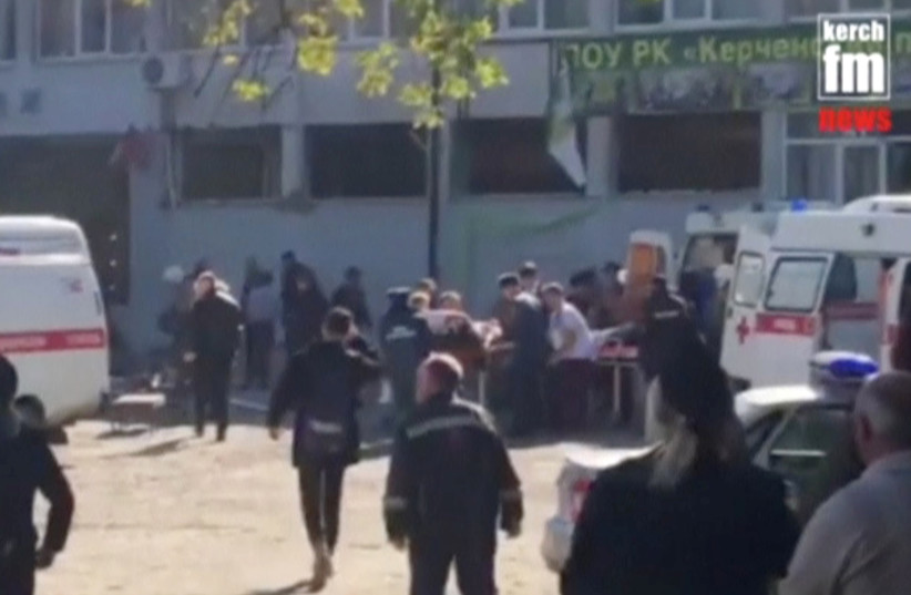 Emergency services carry an injured victim of a blast at at a college in the port city of Kerch, Crimea in this still image taken from a video on October 17, 2018 (photo credit: KERCH/FM/REUTERS)