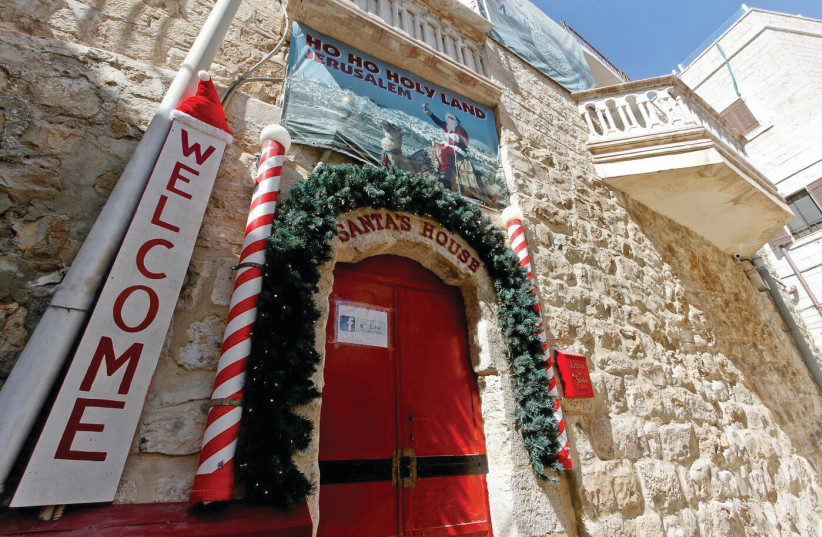 SANTA'S HOUSE in the Christian Quarter of the Old City opens its doors (photo credit: GUY YITZHAKI)
