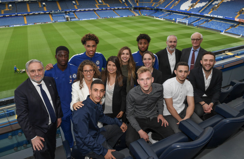 Members of the Chelsea Academy, Chelsea Football Club, the WJC and the winners of Pitch for Hope, Stamford Bridge, 2018 (photo credit: SHAHAR AZRAN / WJC)