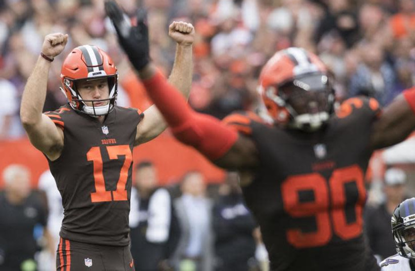 Cleveland Browns kicker Greg Joseph (17) and defensive end Emmanuel Ogbah (90) celebrate after Joseph kicked the game winning field goal in overtime against the Baltimore Ravens (photo credit: KEN BLAZE-USA TODAY SPORTS VIA REUTERS)