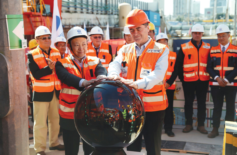 TRANSPORTATION MINISTER Israel Katz (right) and Ambassador Zhan Yongxin of China take part in an event marking the beginning of underground construction work of the light rail, using a Tunnel Boring Machine (TBM) in Tel Aviv, February 2018 (photo credit: REUTERS)