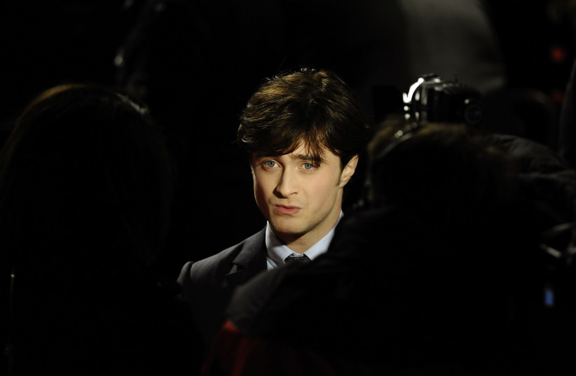 """Britain's Daniel Radcliffe poses as he arrives for the world premiere of """"Harry Potter and the Deathly Hallows: Part 1"""" at Leicester Square in London November 11, 2010.  (photo credit: DYLAN MARTINEZ/REUTERS)"""