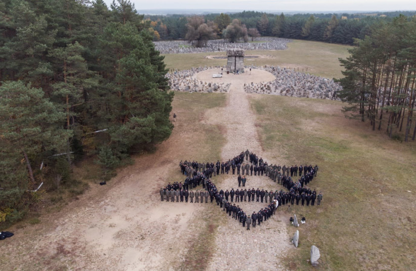 Israel Police posing in formation for at one of the historical sites during the Poland delegation (photo credit: ISRAEL POLICE)