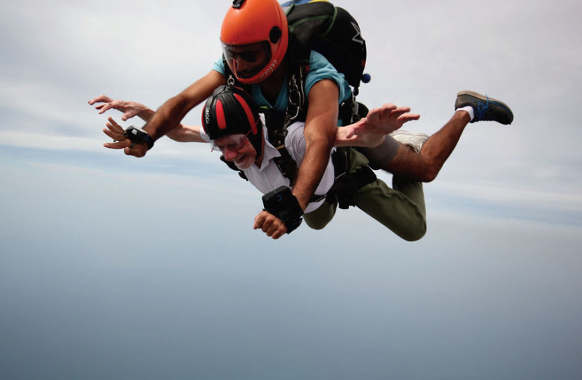 Walter Bingham skydiving with an Israel Extreme instructor over northern Israel (photo credit: ISRAEL EXPERIENCE)