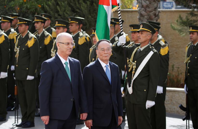 Chinese Vice President Wang Qishan and Palestinian PM Rami Hamdallah, reception ceremony in Ramallah, 2018. (photo credit: ABBAS MOMANI/POOL VIA REUTERS)