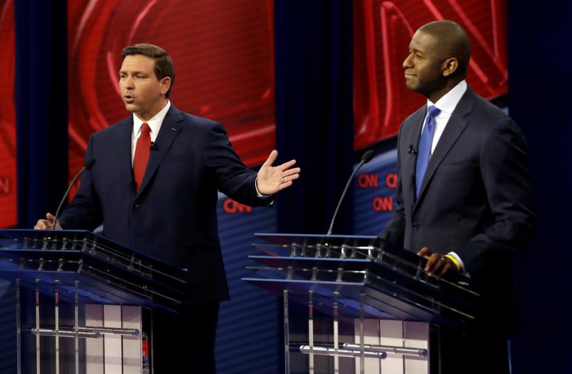 Florida Republican gubernatorial candidate Ron DeSantis (L), speaks during CNN debate with Democratic gubernatorial candidate Andrew Gillum in Tampa, Florida, U.S., October 21, 2018. (photo credit: REUTERS)