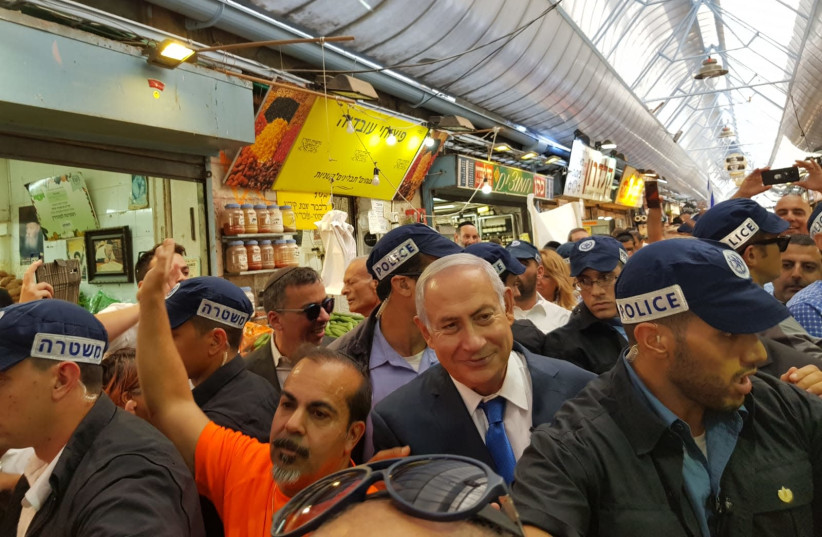 Prime Minister Benjamin Netanyahu visits the shuk in Jerusalem to campaign for municipal elections (photo credit: Courtesy)
