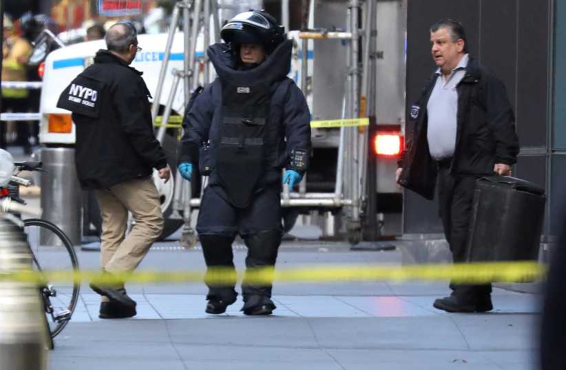 A member of the New York Police Department bomb squad is pictured outside the Time Warner Center in the Manhattan borough of New York City after a suspicious package was found inside the CNN Headquarters in New York, US, October 24, 2018 (photo credit: REUTERS/KEVIN COOMBS)
