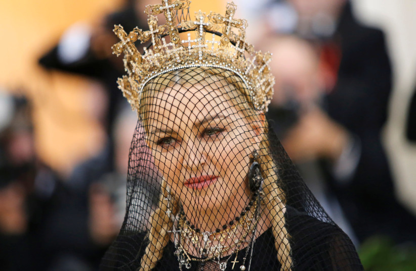 """Madonna arrives at the Metropolitan Museum of Art Costume Institute Gala (Met Gala) to celebrate the opening of """"Heavenly Bodies: Fashion and the Catholic Imagination"""" in the Manhattan borough of New York, U.S., May 7, 2018 (photo credit: REUTERS/EDUARDO MUNOZ)"""