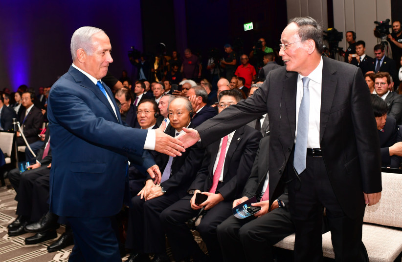 Prime Minister Benjamin Netanyahu greets Chinese VP Wang Qishan at the Innovation Conference in Jerusalem (photo credit: GPO/KOBI GIDEON)