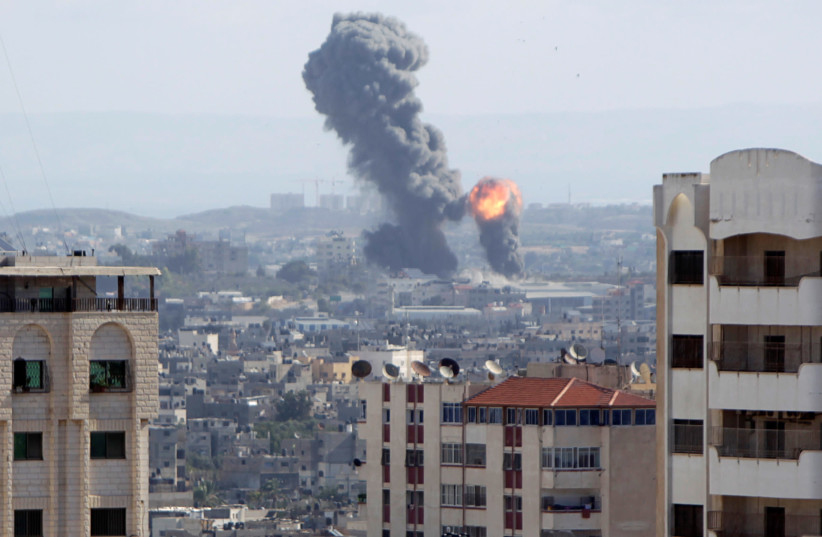 An explosion is seen during Israeli air strikes in Gaza October 27, 2018.  (photo credit: AHMED ZAKOT / REUTERS)