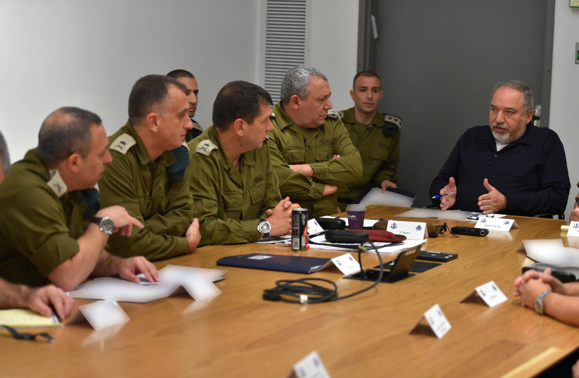 Defense Minister Avigdor Liberman speaking with IDF officers during a special Gaza evaluation meeting  (photo credit: DEFENSE MINISTRY)
