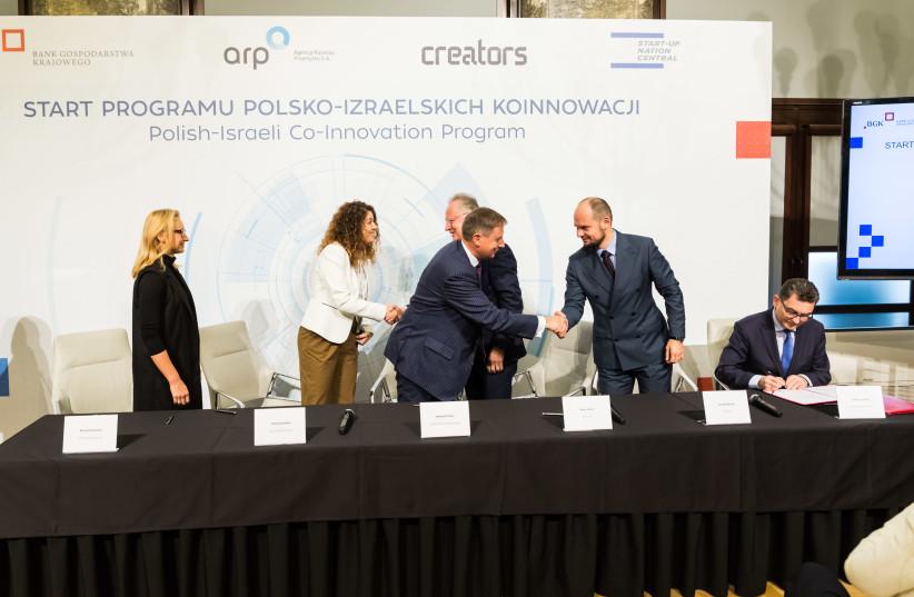Signing ceremony at the launch of the Polish-Israeli Co-Innovation Program in Warsaw, October 24, 2018 (photo credit: BANK GOSPODARSTWA KRAJOWEGO)