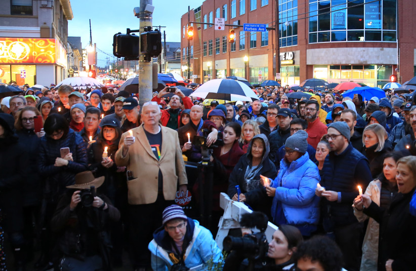 People gathered to mourn the loss of life as they hold a vigil for the victims of Pittsburgh synagogue shooting in Pittsburgh, Pennsylvania, US, October 27, 2018 (photo credit: REUTERS/JOHN ALTDORFER)