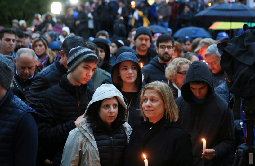 People mourn the loss of life as they hold a vigil for the victims of Pittsburgh synagogue shooting in Pittsburgh, Pennsylvania, October 27, 2018 (photo credit: JOHN ALTDORFER/REUTERS)