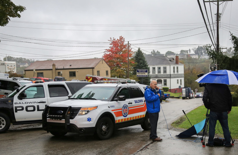 Police vehicles block off the road near the home of Pittsburgh synagogue shooting suspect Robert Bowers' home in Baldwin Baldwin borough, suburb of Pittsburgh, Pennsylvania, October 27, 2018 (photo credit: JOHN ALTDORFER/REUTERS)
