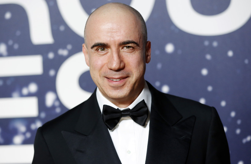Russian entrepreneur and venture capitalist Yuri Milner arrives on the red carpet during the second annual Breakthrough Prize Awards at the NASA Ames Research Center in Mountain View, California November 9, 2014 (photo credit: REUTERS/STEPHEN LAM)