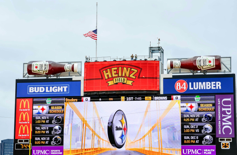 Pittsburgh, PA, USA - Heinz field in Pittsburgh lowers the flag to half-staff to honor the victims of the shooting at the Tree of Life Synagogue before the game between the Pittsburgh Steelers and the Cleveland Browns (photo credit: JEFFREY BECKER-USA TODAY SPORTS)