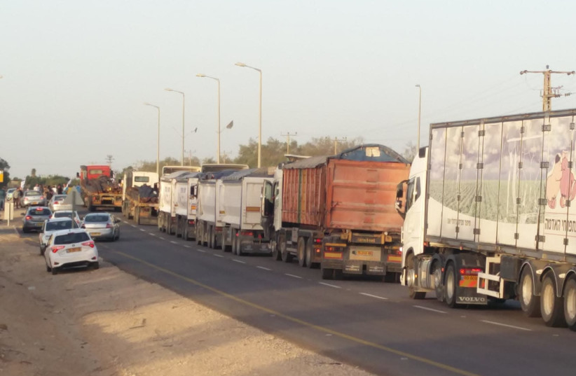 Activists block dozens of trucks from delivering supplies into Gaza. (photo credit: IM TIRTZU)