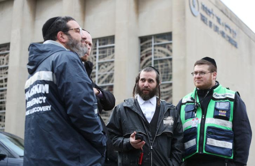 A crew from Chesed Shel Emes Emergency Services and Recovery Unit arrive at the Tree of Life synagogue where 11 worshippers were murdered during Saturday's shooting at the synagogue in Pittsburgh (photo credit: REUTERS/CATHAL MCNAUGHTON)