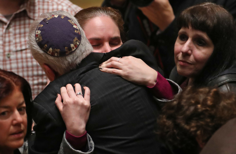 Mourners react during a memorial service at the Sailors and Soldiers Memorial Hall of the University of Pittsburgh, a day after 11 worshippers were shot dead at a Jewish synagogue in Pittsburgh, Pennsylvania, October 28, 2018 (photo credit: CATHAL MCNAUGHTON/REUTERS)