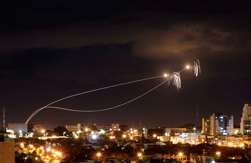 Iron Dome anti-missile system fires interception missiles as rockets are launched from Gaza towards Israel as seen from the city of Ashkelon, Israel October 27, 2018. Picture taken with long exposure (photo credit: AMIR COHEN/REUTERS)