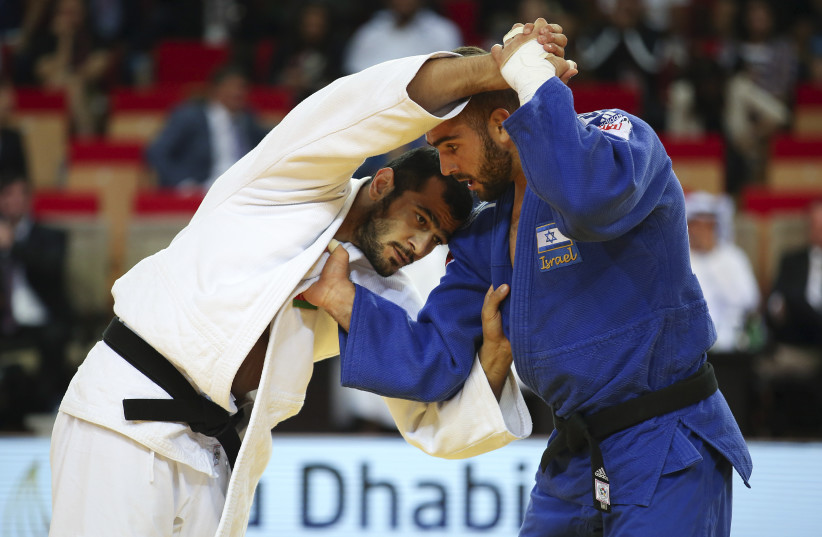 Peter Paltchik from Israel (blue) fights with against Gasimov Elmar (white) from Azerbaijan in the final of the under 100 kg weight category during the Judo Grand Slam 2018 in Abu Dhabi, on October 29, 2018 (photo credit: MAHMOUD KHALED / AFP)