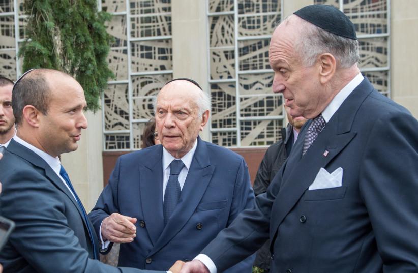 Diaspora Affairs Minister Naftali Bennett greets World Jewish Congress President Ronald Lauder in Pittsburgh on Monday (photo credit: ALEXI ROSENFELD)