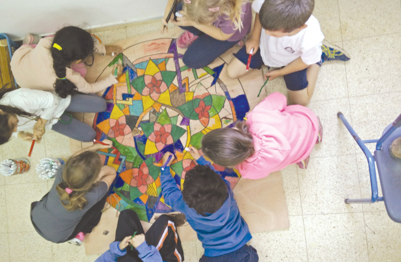 CREATIVE PEACE-MAKING projects like this one supported by the Jewish Federations, help children make a positive connection to their community and build resilience (photo credit: Courtesy)