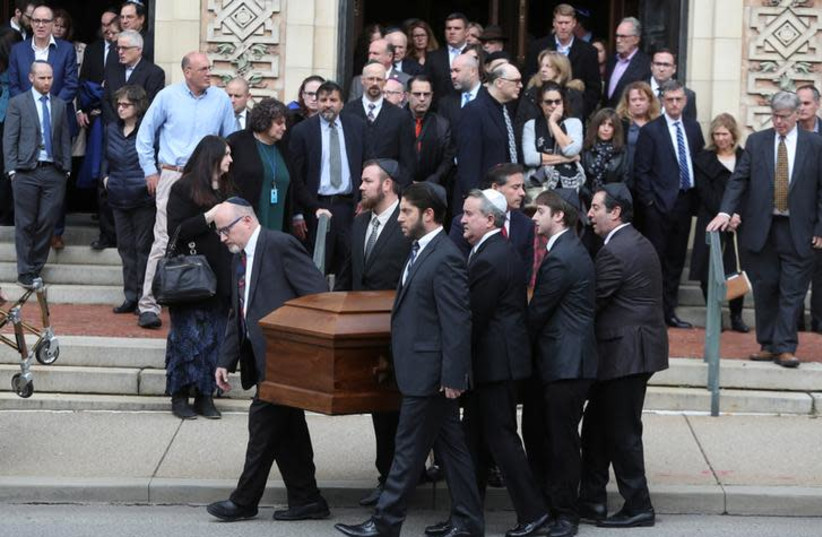 A casket is carried from Rodef Shalom Temple after funeral services for brothers Cecil and David Rosenthal, victims of the Tree of Life Synagogue shooting, in Pittsburgh, Pennsylvania, U.S., October 30, 2018 (photo credit: CATHAL MCNAUGHTON/REUTERS)