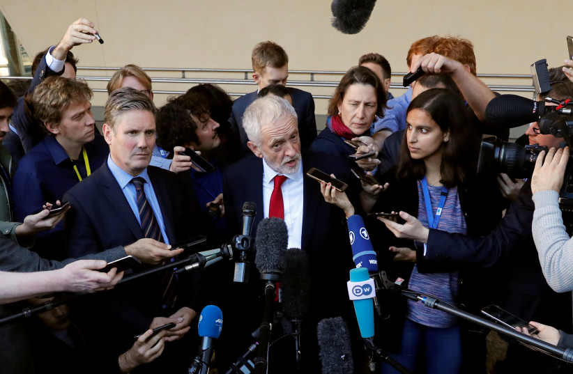 British Labour party opposition leader Jeremy Corbyn talks to reporters after a meeting with European Union's chief Brexit negotiator Michel Barnier at the EC headquarters in Brussels, Belgium September 27, 2018 (photo credit: YVES HERMAN / REUTERS)